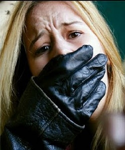 glove over mouth of woman