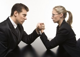 man and woman arm-wrestling