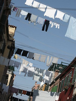 clothes hanging outside apartment buildings