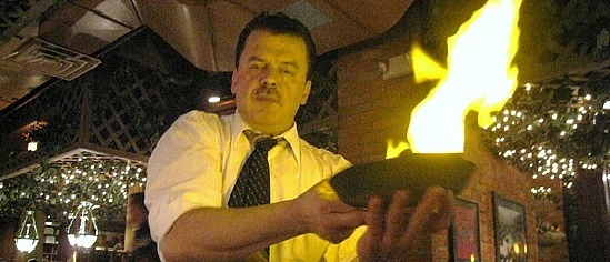 man cooking in flames